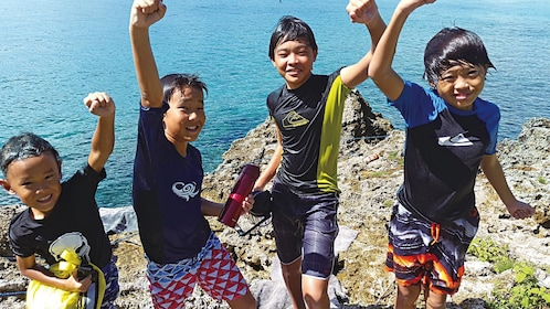 Young boys on the Saipan Sea Jumping and Nature Snorkeling Tour