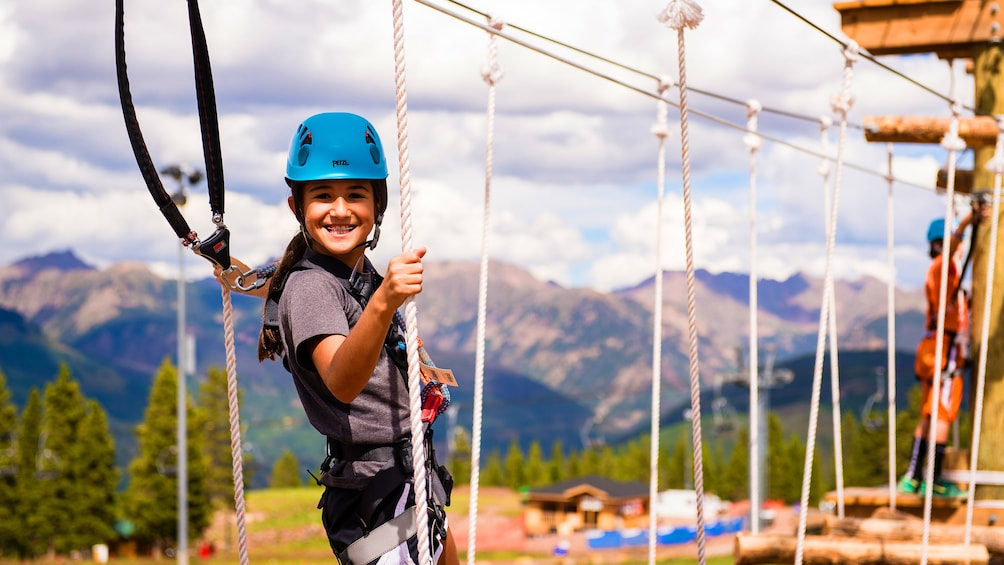 Show item 3 of 5. Girl on a rope course