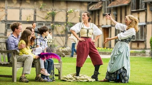 Family with performers at Shakespeare's family home in Stratford-upon-Avon