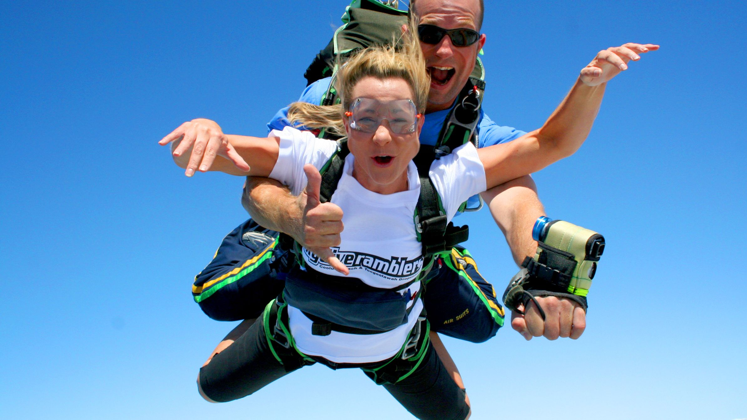 Two fastened skydivers free falling over Sunshine Coast.