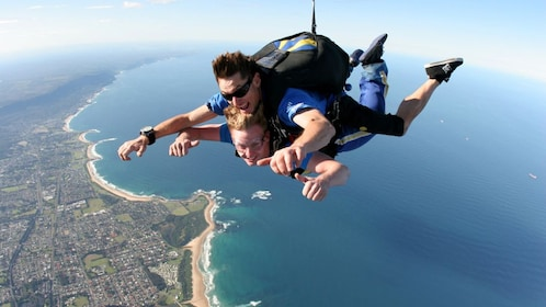 two men sky dive miles over landscape in Wollongong