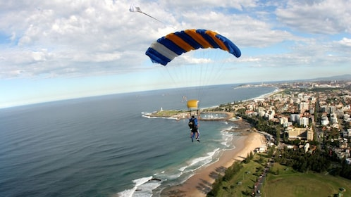 skydivers parachute over the beaches in Wollongong