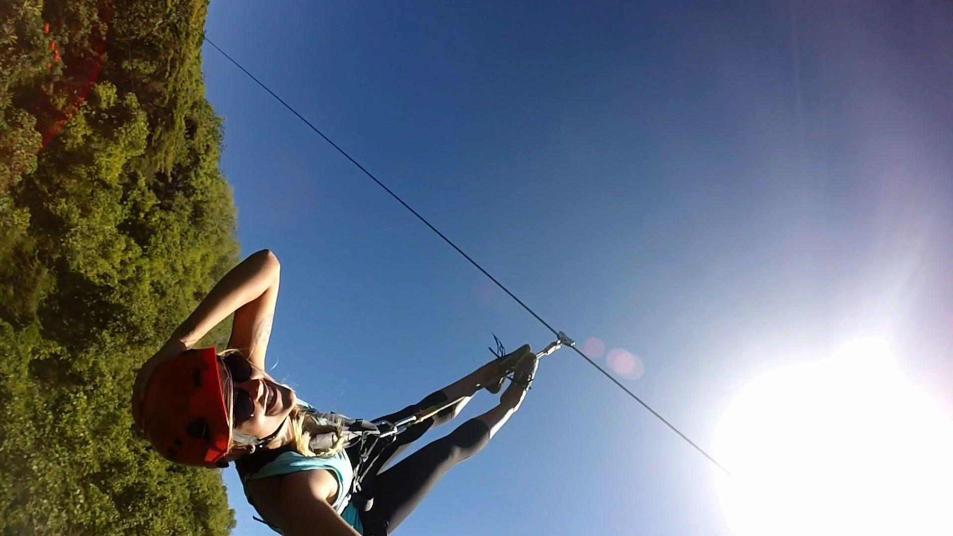 Woman ziplining on Kauai