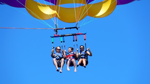 Family parasailing off of boat in Punta Cana