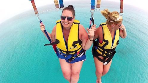 Two women enjoying the view while parasailing in Punta Cana