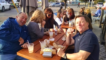 Show item 3 of 4. Group enjoying tacos outside of restaurant in Dallas
