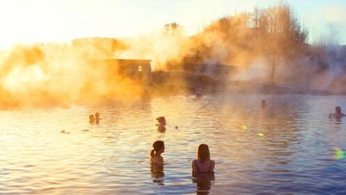 People at an Icelandic geothermal lagoon at dusk