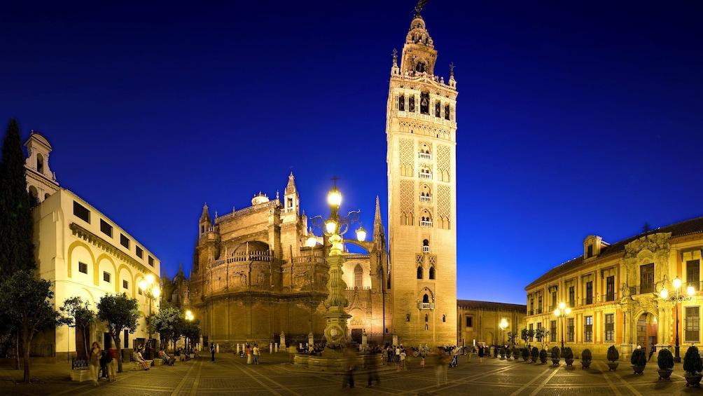 Show item 3 of 5. Giralda lit up at night in Seville