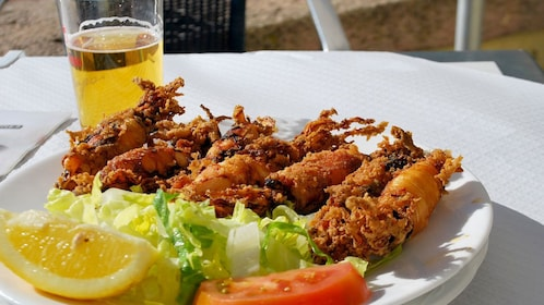 Fried squid with beer on tour in Seville