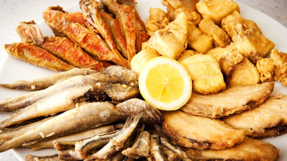 Show item 1 of 6. Variety of fried fish on platter in Seville