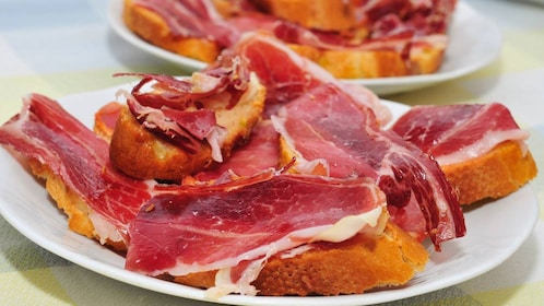 Bread and sliced meat cuisine in Seville