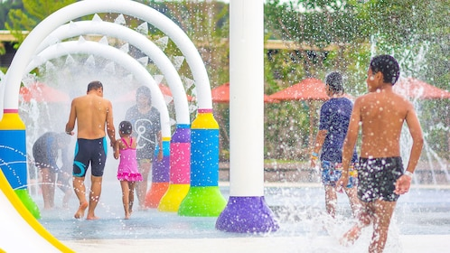 Children playing in water at Ramayana Water Park in Bangkok