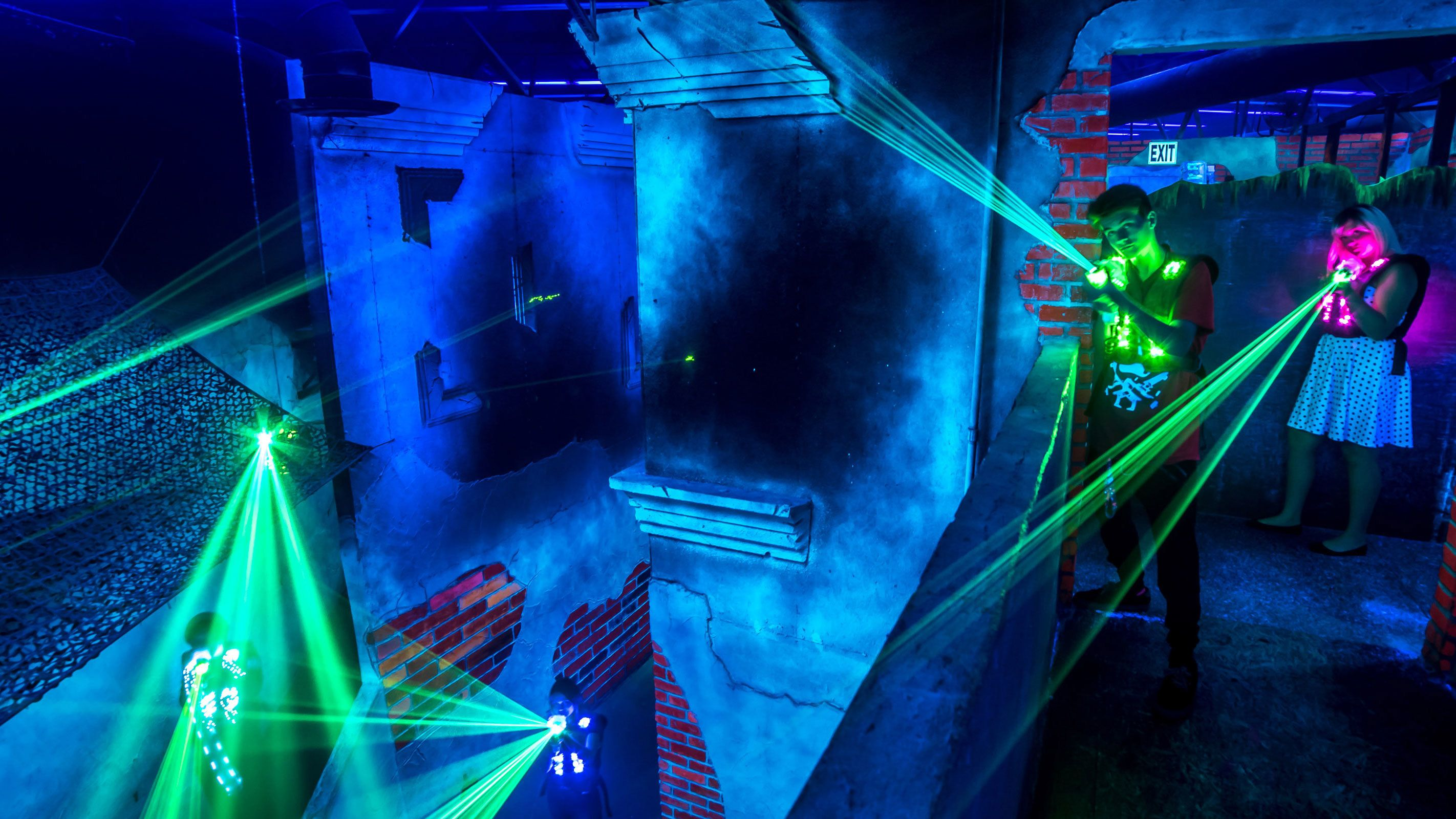 Lasers shining through room at battleBLAST Laser Tag