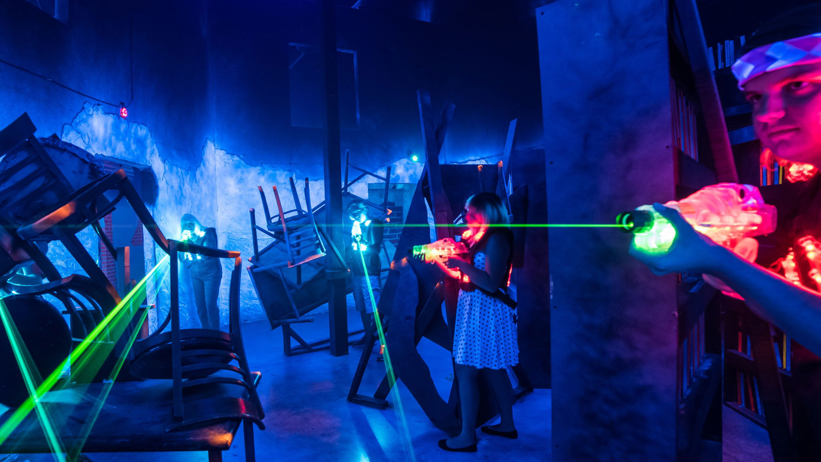 People firing laser guns during match at battleBLAST Laser Tag in Las Vegas