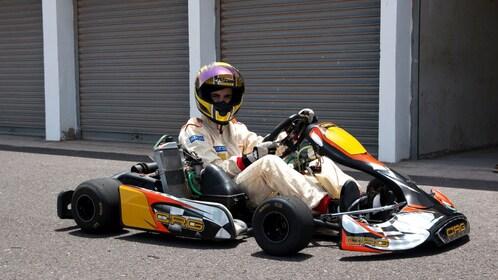 Man in full racing suit and helmet on go kart in Lanzarote