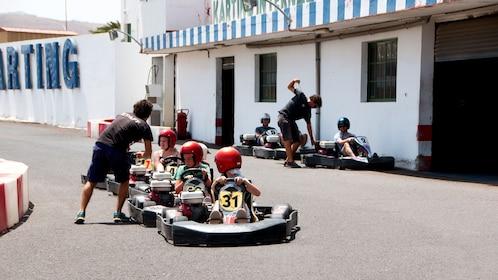 Staff starting up children's go karts in Lanzarote