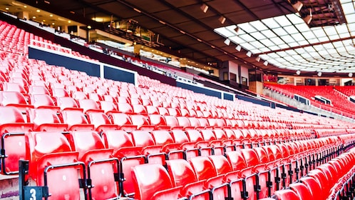 Row after row of seating in Manchester United stadium during tour
