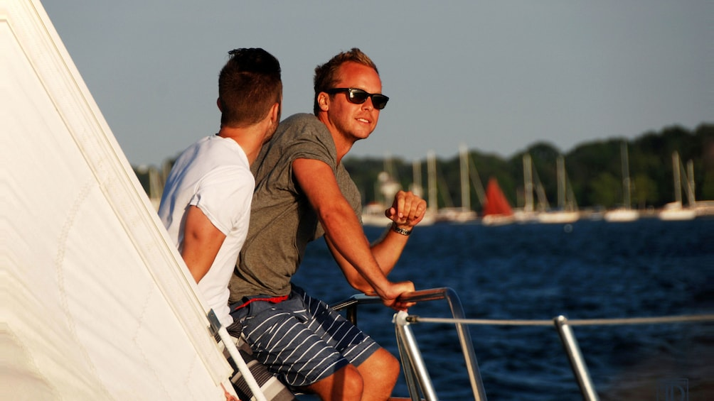 Show item 5 of 5. Men on a sailboat in Newport