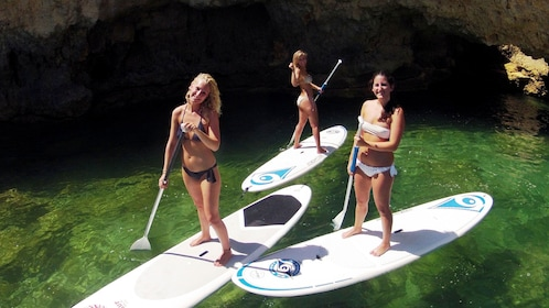 Group of women on stand-up paddles in Algarve