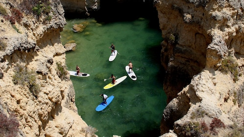 Looking down at a group on stand-up paddles in Algarve