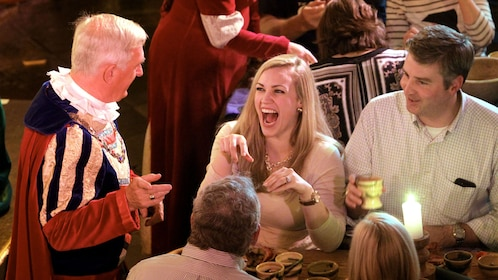 Woman laughing at Medieval banquet at Bunratty Castle in Dublin
