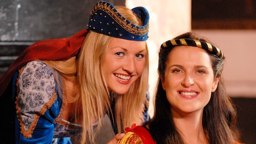 Pair of women in medieval costumes at Bunratty Castle in Dublin