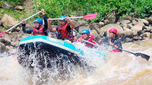 Group on the Padas River White Water Rafting Grade III-IV