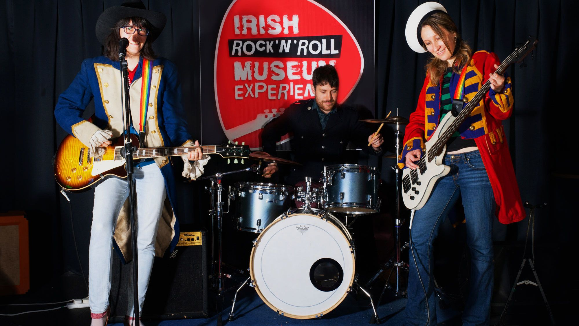 Tour group playing instruments at the Irish Rock N Roll Museum in Dublin