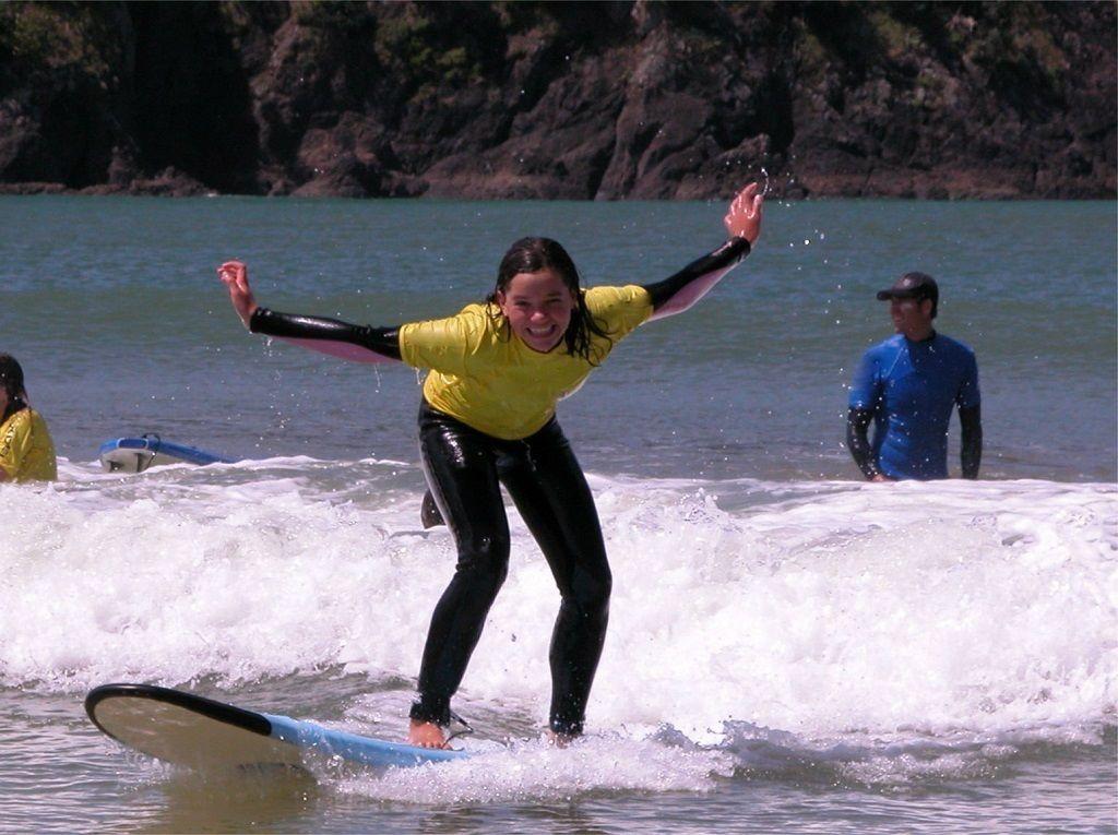 Girl on surfboard on Tutukaka Coast