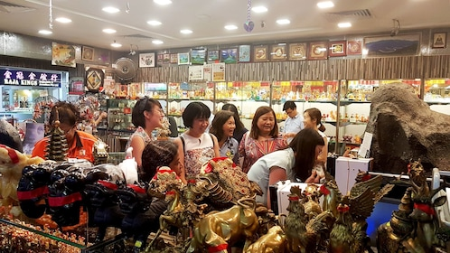 Tour group with guide in market in Singapore
