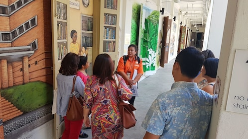 Tour group with guide in museum in Singapore