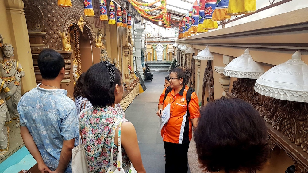 Tour group with guide in temple in Singapore