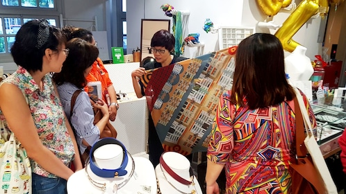 Tour group looking at textiles while on tour in Singapore
