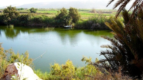 Small boat moored on shore on far side of river on Agadir