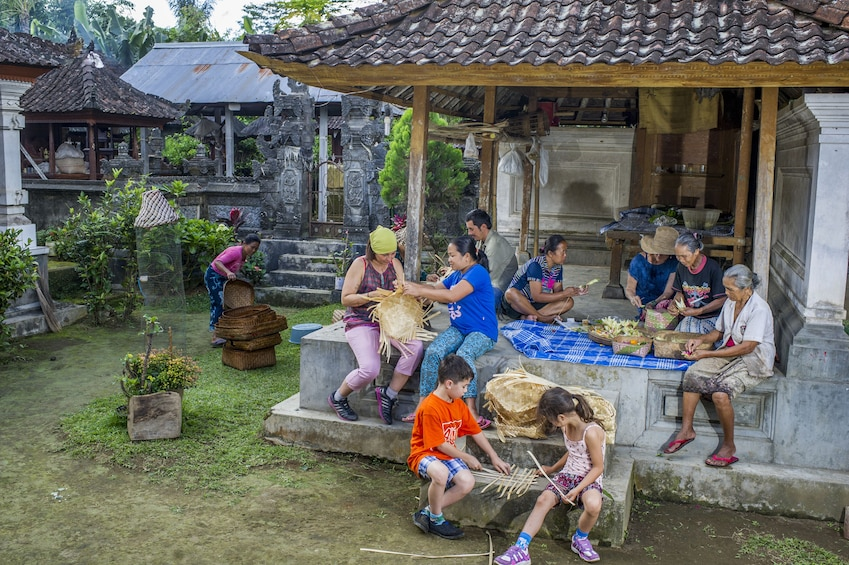 Show item 10 of 10. Group weaving baskets in Bali