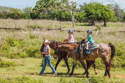 Tour being led on horseback at Gunstock Ranch