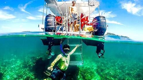 Snorkeler underwater near boat in Kota Kinabalu