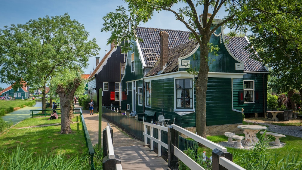 Show item 1 of 9. House along a plank path in the Netherlands