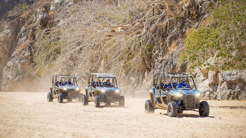 Off-road buggies traveling in line in Los Cabos