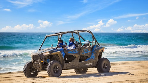 People driving around off-road buggy on beach in Los Cabos