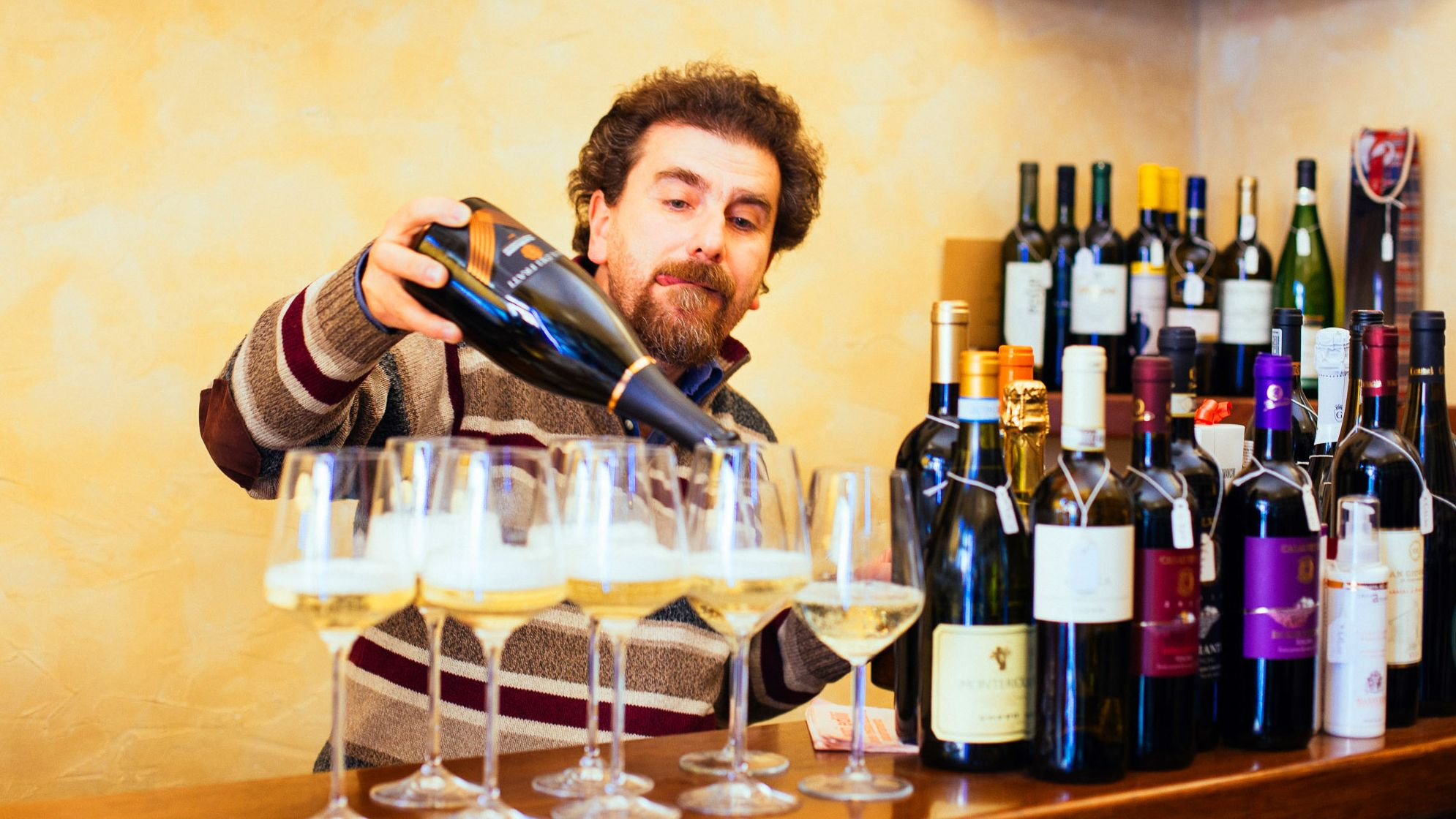 Wine Sommelier pouring Prosecco in glasses