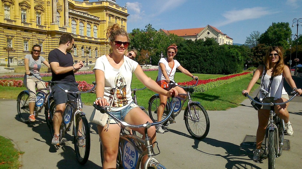 Show item 2 of 10. Bicycle group pedaling off to next attraction in Zagreb