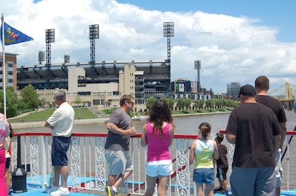 People viewing stadium from river boat in Pittsburgh