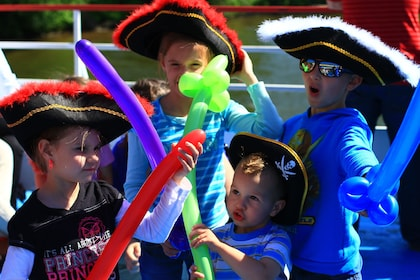 Children with pirate hats and balloon swords on river boat in Pittsburgh