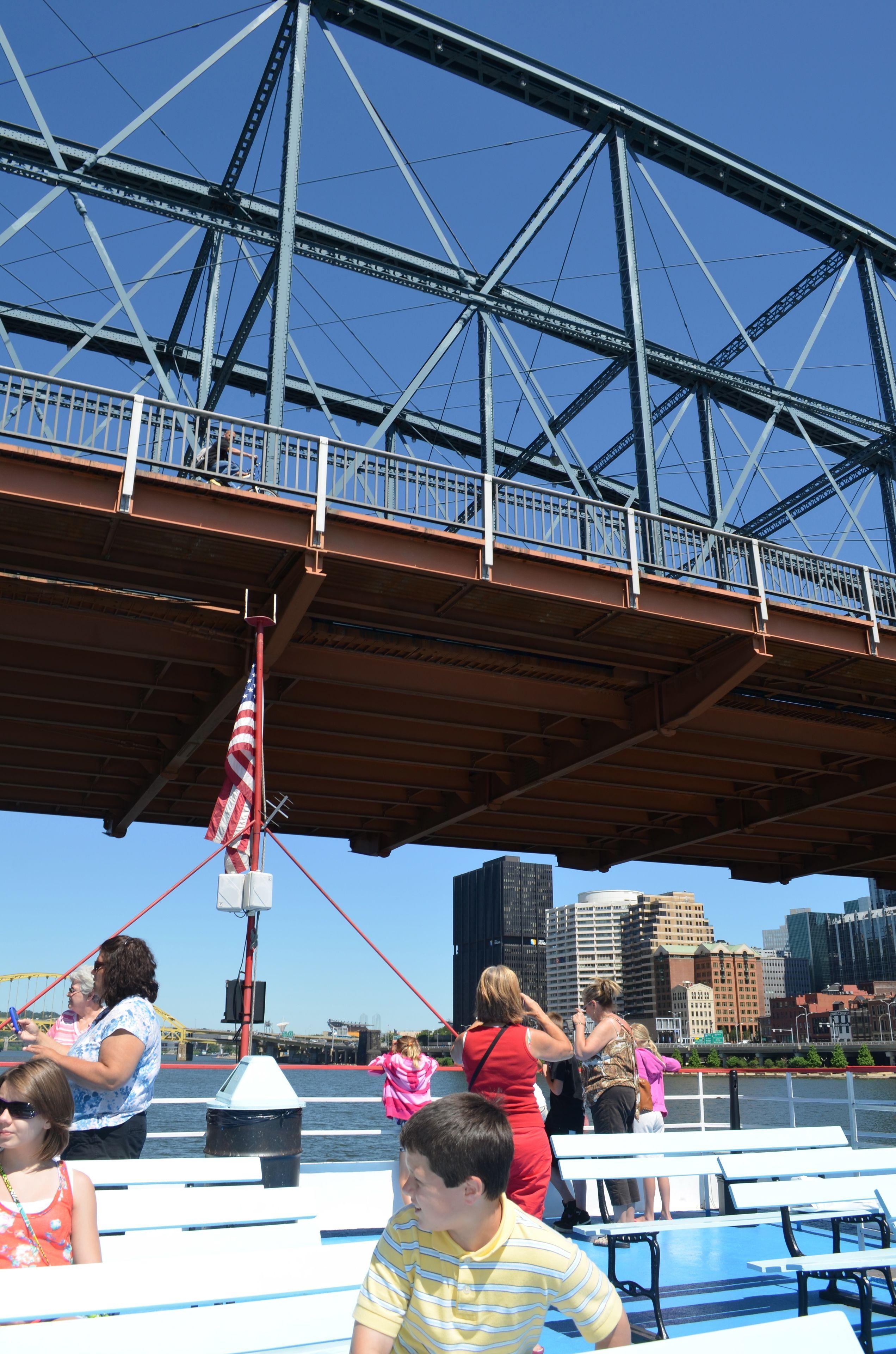 River boat traveling under bridge in Pittsburgh