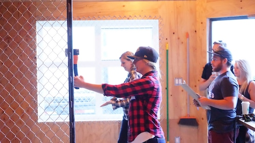Women throwing axes at Forged Axe Throwing in Whistler