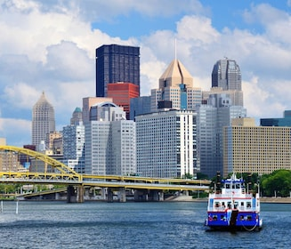 Boat on the river with city in the background in Pittsburgh