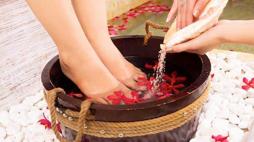 Woman getting a foot treatment from the Somatic Therapy Package in Ho Chi Minh City