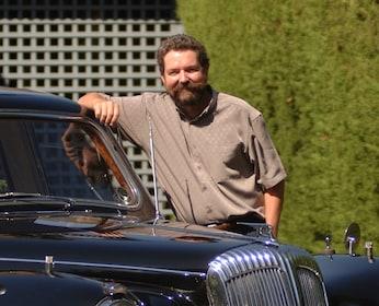 Driver next to 1962 Daimler