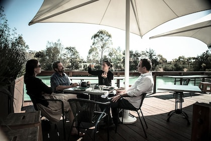 Four people at an outdoor patio at a Barossa Daimier winery